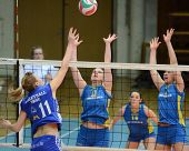 KAPOSVAR, HUNGARY - FEBRUARY 13: Barbara Balajcza (R) blocks the ball at the Hungarian NB I. League