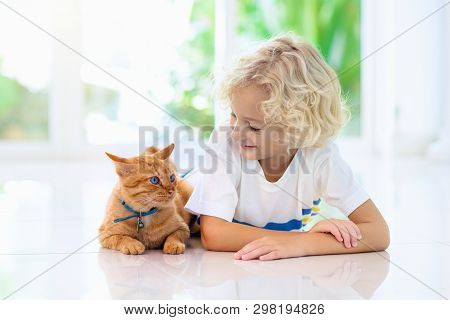 poster of Child Feeding Home Cat. Kids And Pets.