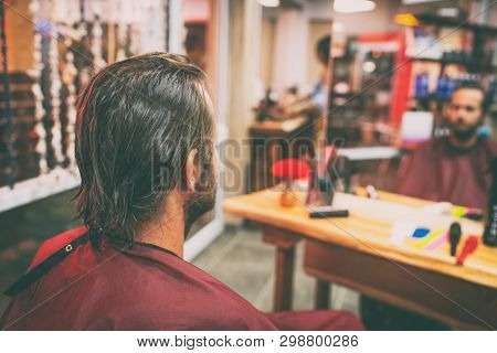 poster of Hair salon man getting haircut or coloring of long brown hair. Portrait from behind of male customer