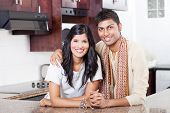 beautiful young indian couple portrait at home