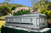 stock photo of funeral  - Image of a stainless steel Casket with Flowers - JPG
