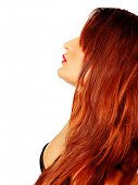 beautiful young woman with long red hair wearing a black bra in profile with red lips on white backg