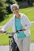 Senior Woman With Her Bicycle