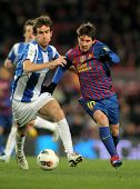 BARCELONA - FEB, 4: Mikel Gonzalez(L) of Real Sociedad vies with Leo Messi(R) of FC Barcelona during
