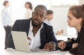 Black Broker Insurer Consulting Working With Client Looking At Laptop poster