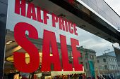 Half Price Sale Sign In A Shop Window.
