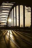 picture of old bridge  - An old bridge construction silhouette on sunset - JPG