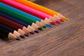 A Lot Of Colored Pencils Lying On A Wooden Table. Pencils Close Up. Color Pencils On Wooden Backgrou poster