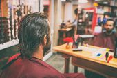 Hair salon man getting haircut or coloring of long brown hair. Portrait from behind of male customer poster