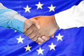 Business Handshake On European Union Flag Background. Men Shaking Hands And European Union Flag On B poster