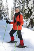 pic of senior-citizen  - Seventy year old lady having fun snowshoeing on Mount Seymour - JPG