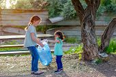 Two Kids Volunteer Charity Environment.children With Garbage Bags Cleaning Up Polluted Environmental poster