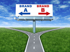 picture of b-double  - Choosing brands and branding loyalty represented by a horizontal billboard with a choice of brand a and brand b sitting on a cross roads with green grass and sky showing the concept of marketing and promotion - JPG