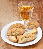 Sweet White Wine And Italian Almond Cantuccini On Table