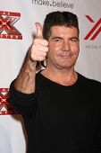 LOS ANGELES - DEC 6:  Simon Cowell arrives to the X Factor 2012 Final Four Party at Rodeo Drive on D