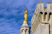 stock photo of avignon  - Monument on the top of cathedral in Avignon castle of popes - JPG