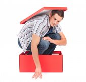 Young man in a box, seems stuck in his thoughts.