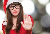 christmas woman doing a stop gesture against an abstract background