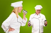 Portrait Of Two Chef Isolated On Green Background