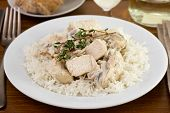 Chicken Breast With Mushrooms, Sceams And Rice On The White Plate