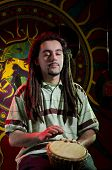 stock photo of rastaman  - Young rastaman is performing on the stage - JPG