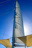 Looking at boat mast with rigging and blue sky