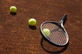 Tennis balls and rocket