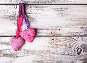 picture of lovable  - Crochet valentine hearts handing on the rope - JPG