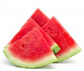stock photo of watermelon slices  - closeup of some pieces of refreshing watermelon on a white background - JPG