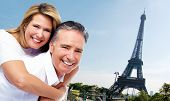 Senior couple near Eiffel tower. Tourism and traveling background.