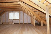 stock photo of trapezoid  - Attic in wooden house under construction overall interior view - JPG