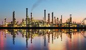 stock photo of chimney  - Oil and gas refinery at twilight with reflection  - JPG