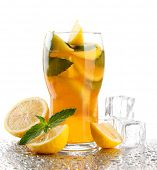 Iced tea with lemon and mint isolated on white
