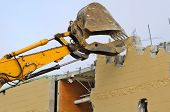 pic of track-hoe  - Tracked Excavator removing a wall on a major remodel of a chain department store - JPG