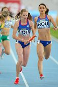 BARCELONA - JULY, 14: Bianca Razor(L) and Roxana Ene(R) of Romania competes on 4X400 Relay of the 20th World Junior Athletics Championships at the Olympic Stadium on July 14, 2012 in Barcelona, Spain
