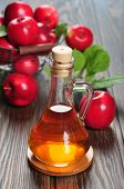 stock photo of cider apples  - Apple cider vinegar in glass bottle and basket with fresh apples