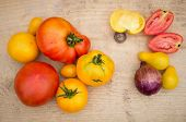 red and yellow tomatoes on wooden board