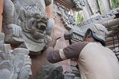 Bali, Indonesia-june 25Th: A Sculptor At Work On A Temple In Ubud On 25Th June 2012. Bali Is Famous
