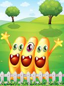 Illustration of the three happy orange monster near the fence