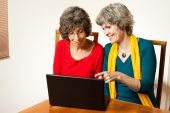 Laughing senior internet users