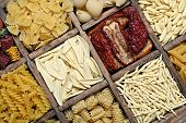 foto of pene  - Backgroung image of italian pasta and dried tomatoes - JPG