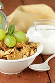 healthy breakfast of muesli with milk and green grapes