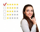 Beautiful Woman Choose Five Stars Rating In Feedback. Good Result