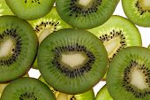 slices of fresh green fruit kiwi isolated on white background