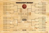 stock photo of superimpose  - Basketball tournament bracket superimposed on a wood gym floor - JPG