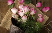 Pink Roses On Burlap With Metal Bucket From Above