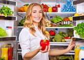 picture of vegetarian meal  - Woman chosen milk in opened refrigerator - JPG