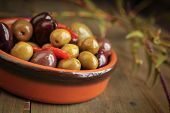 stock photo of kalamata olives  - Variety of olives in a bowl on wooden table - JPG