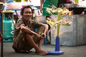 AYUTTHAYA, THAILAND - MAR 11: An unidentified beggar sells handicrafts near Ayutthaya Historical Par
