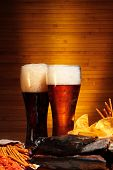 image of crawdads  - Glasses of dark and light beer with cips and snacks - JPG